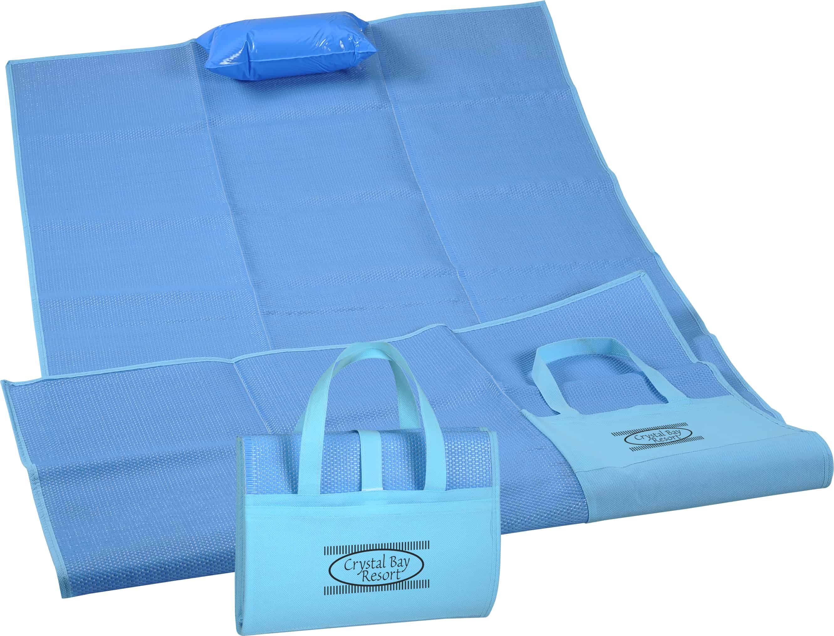 A blue Surf & Sand Beach Mat with inflatable pillow.