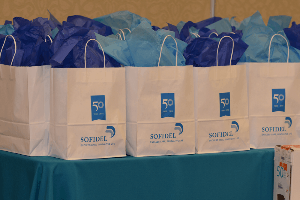 White paper gift bags with blue tissue paper inside