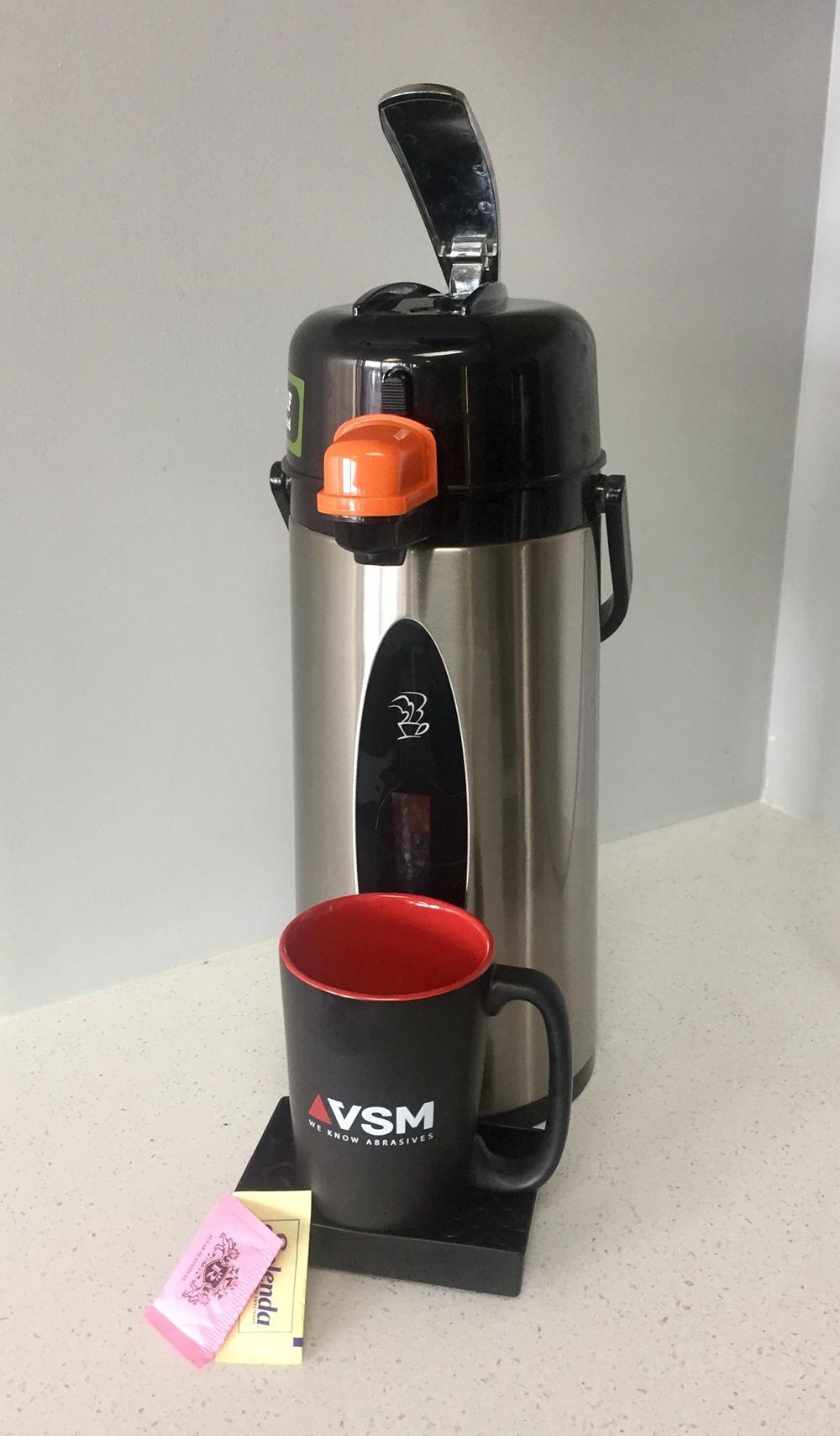 Coffee maker and black and red coffee mug
