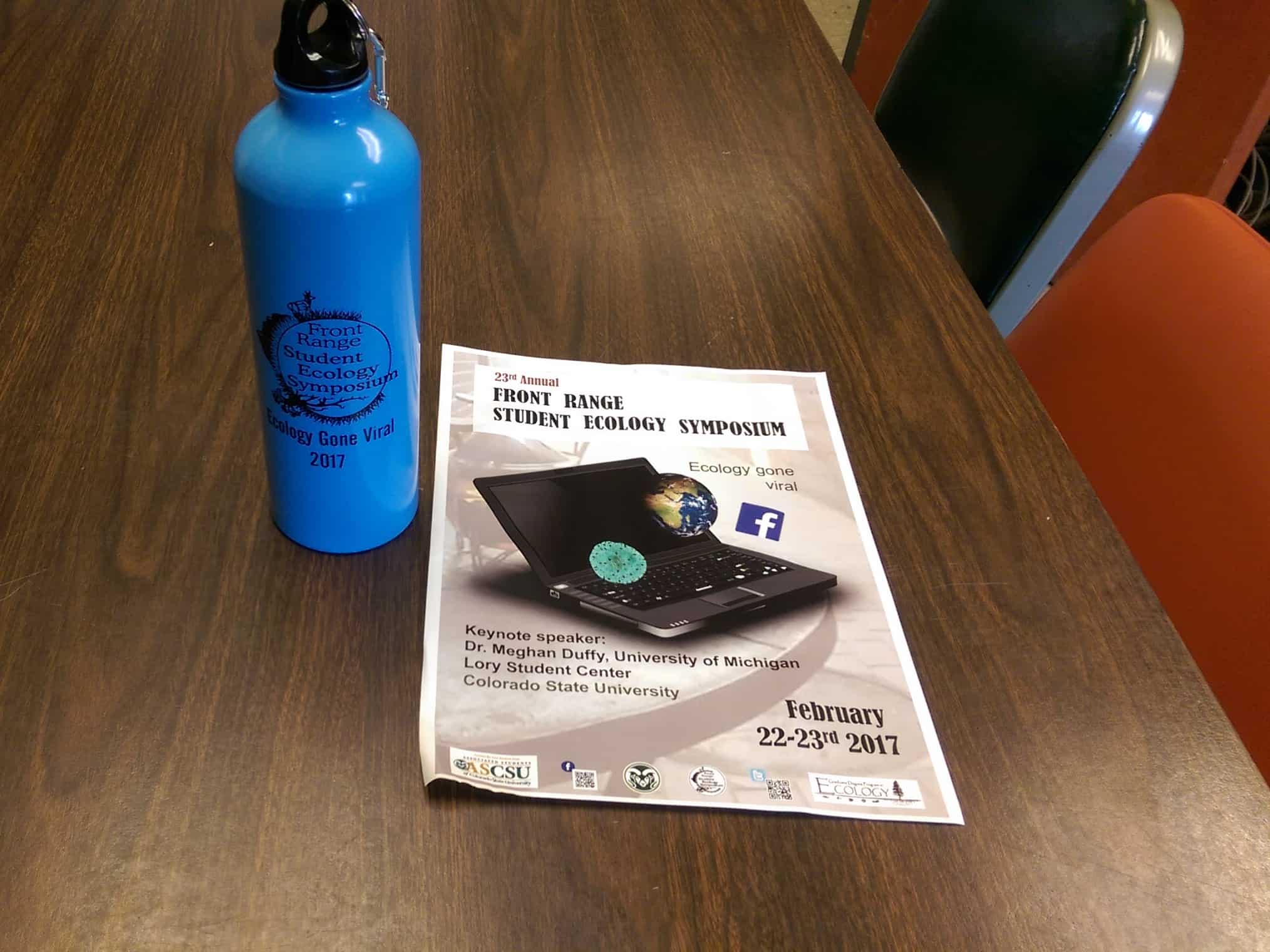 Blue metal water bottle with pamphlet