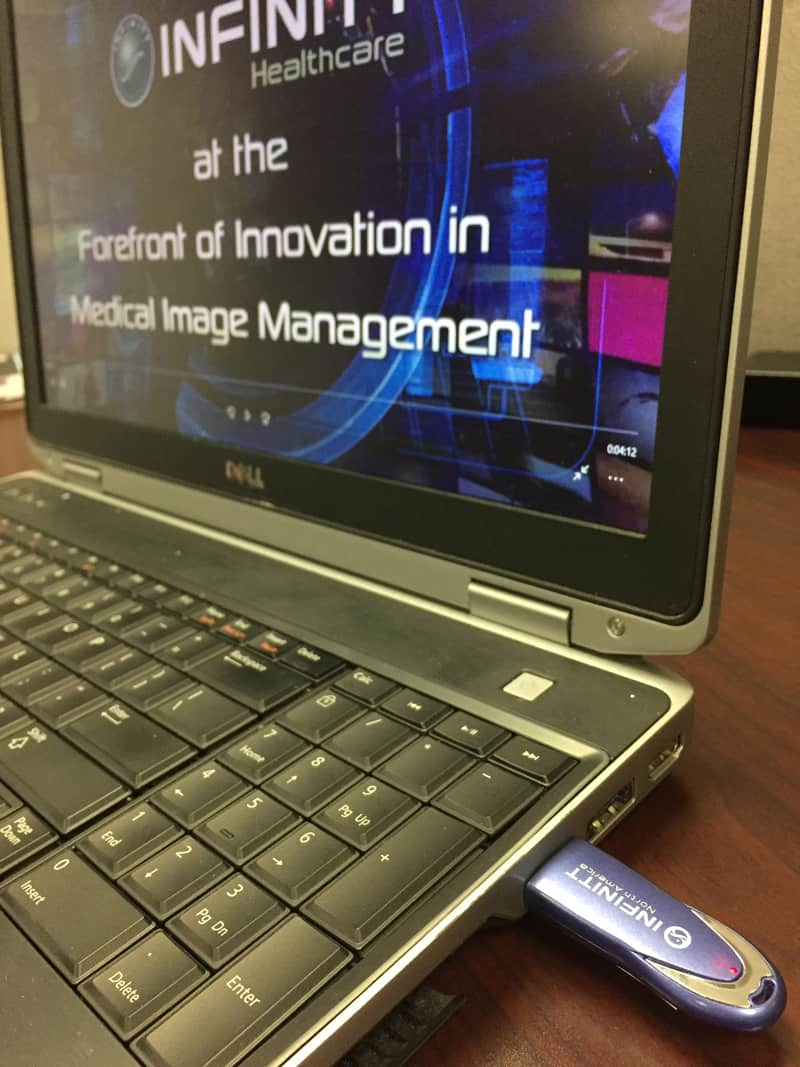 Laptop with USB thumb drive inserted