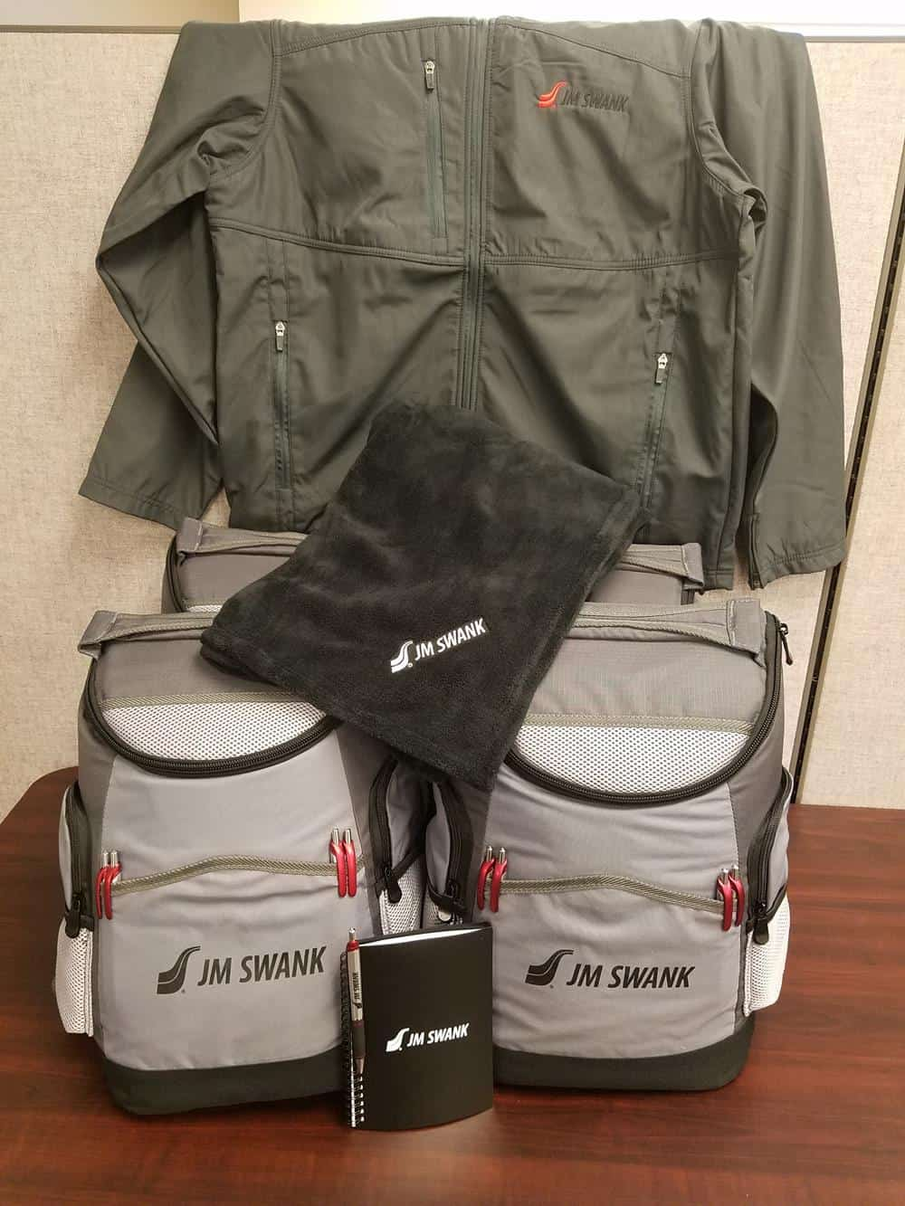 Gray backpack cooler, blanket, notebook with pen and jacket
