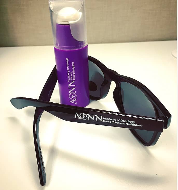 Black sunglasses and a purple personal fan