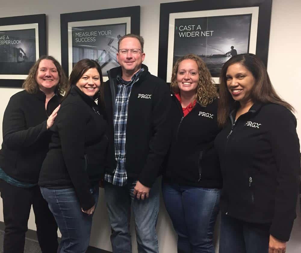 Group of staff members wearing branded black fleece jackets