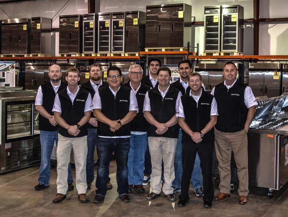 Group of salesmen wearing company vests