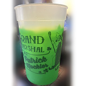 White and green plastic mood cup