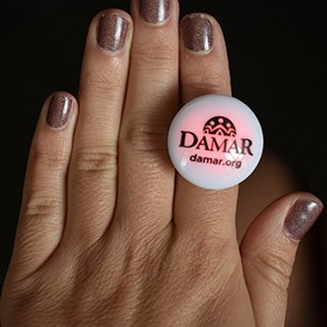 Hand with red and white glow ring on the index finger