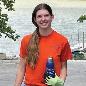 Female volunteer holding reusable water bottle.