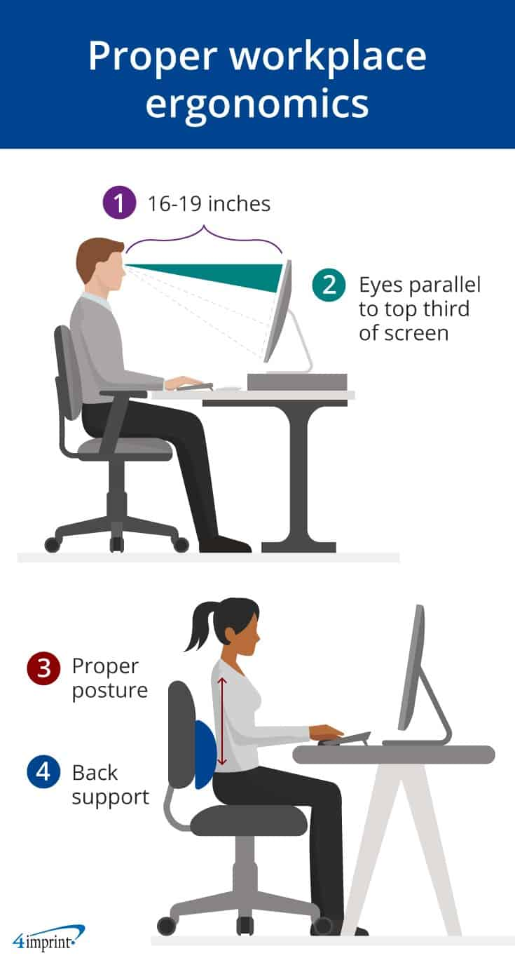 Man and woman sitting at desk and practicing proper workplace ergonomics