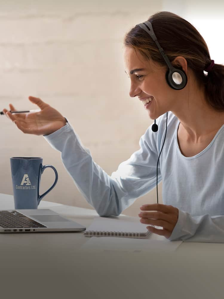 Woman with headphones looking at computer