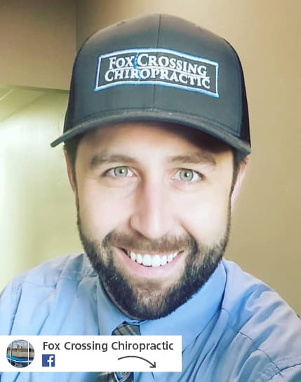 man wearing Fox Crossing Chiropractic branded ball cap