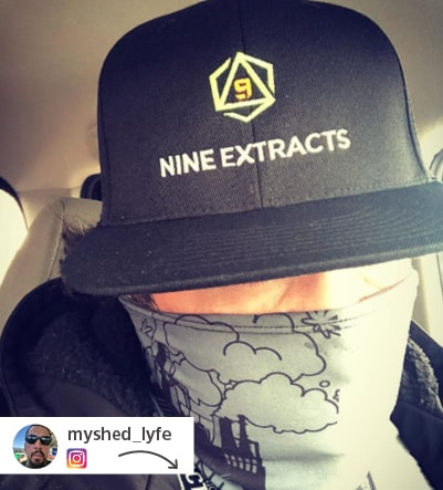 Guy wearing Nine Extracts branded ball cap