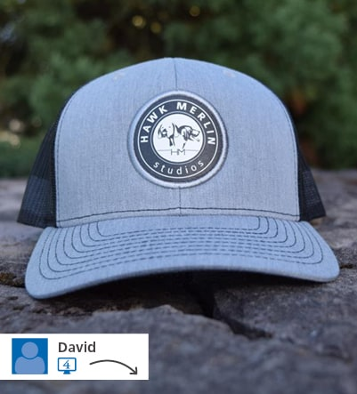 promotional ball cap with raised embroidered circle logo on front
