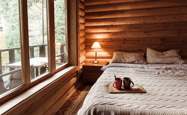 bedroom in log cabin vacation home