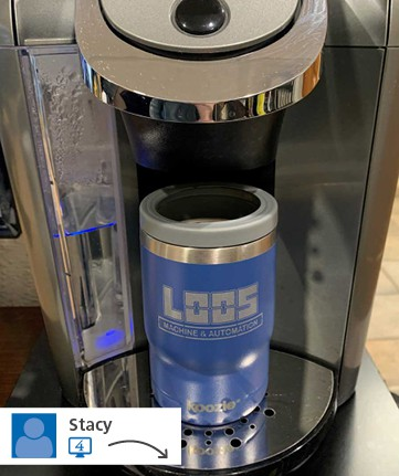 Promotional travel coffee mug in coffee dispenser