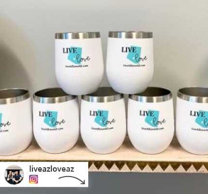 tower of stacked branded travel wine tumblers.