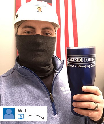 Man wearing facemask and hard hat holding branded company travel tumbler
