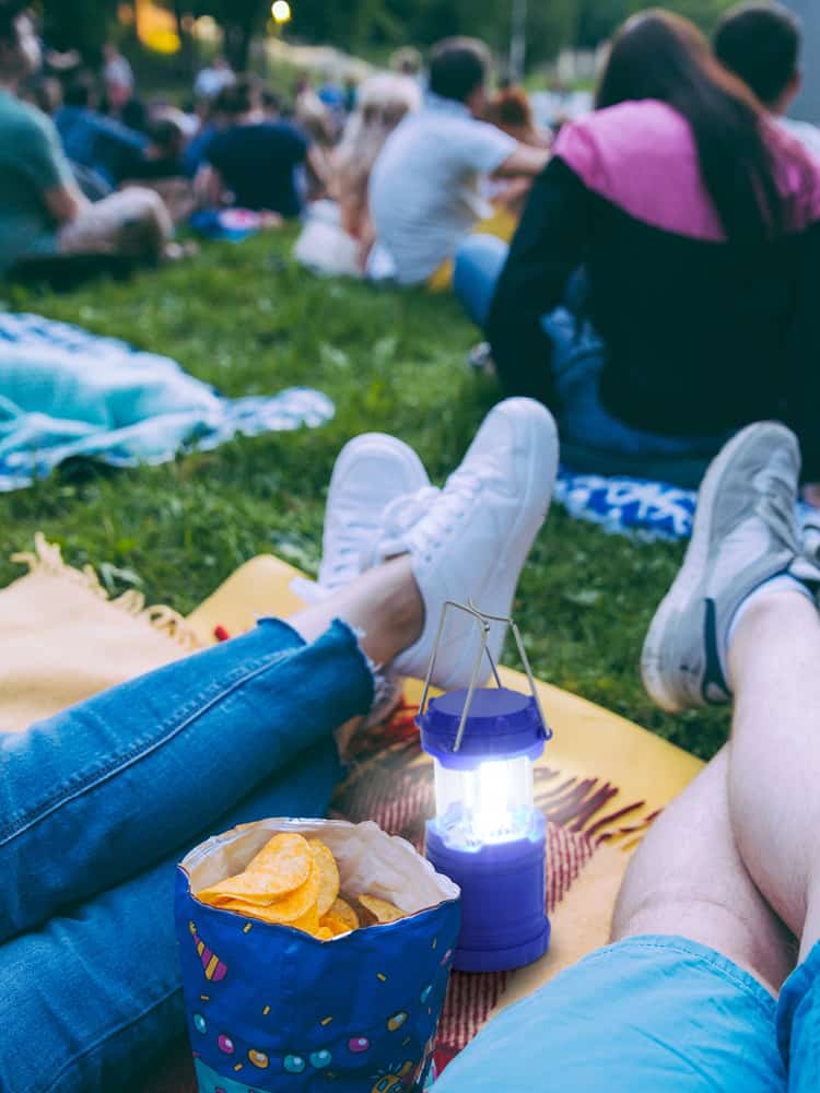 People sitting on blanket at outdoor event