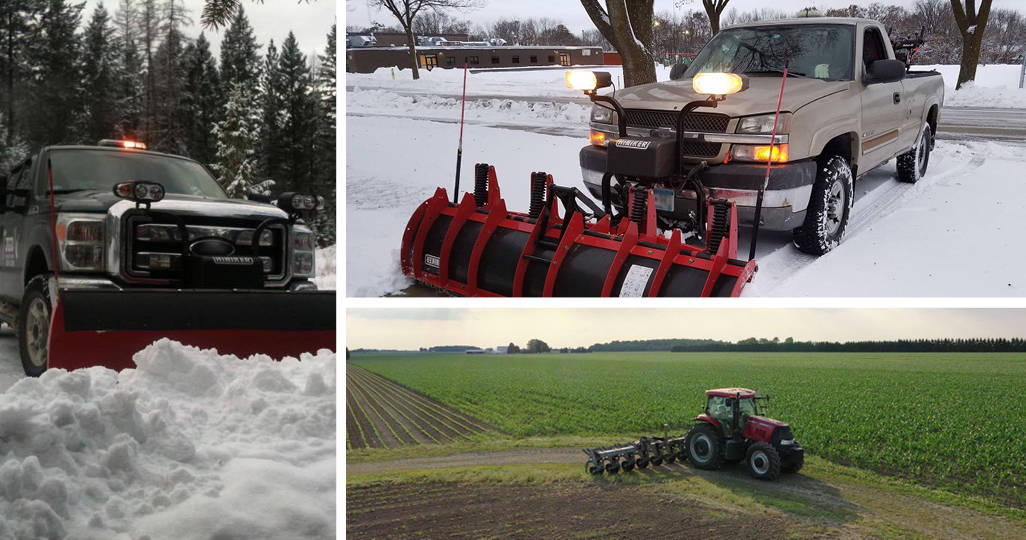 two trucks with Hiniker snow plows and a tractor with Hiniker farming equipment on it