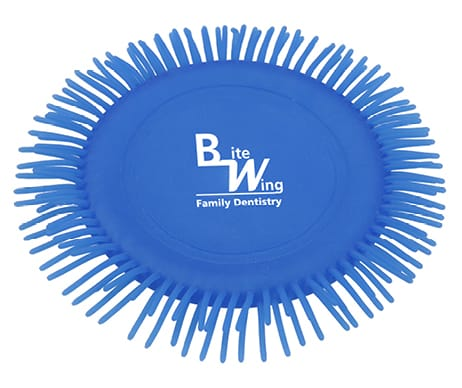 Blue toy disk that is made of squishy thermal plastic rubber with strings around edges