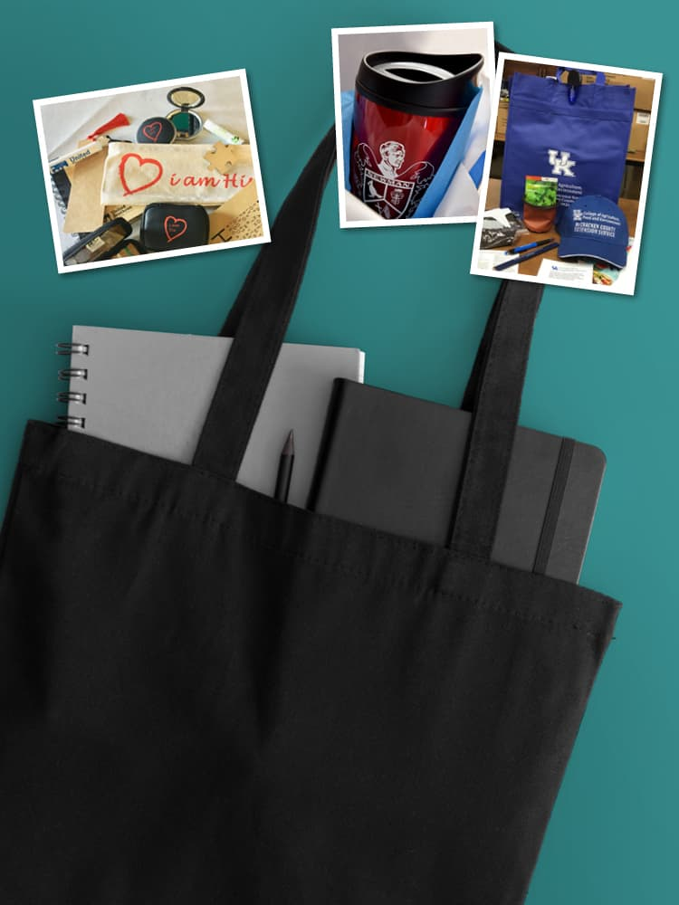 Black tote with promotional items inside