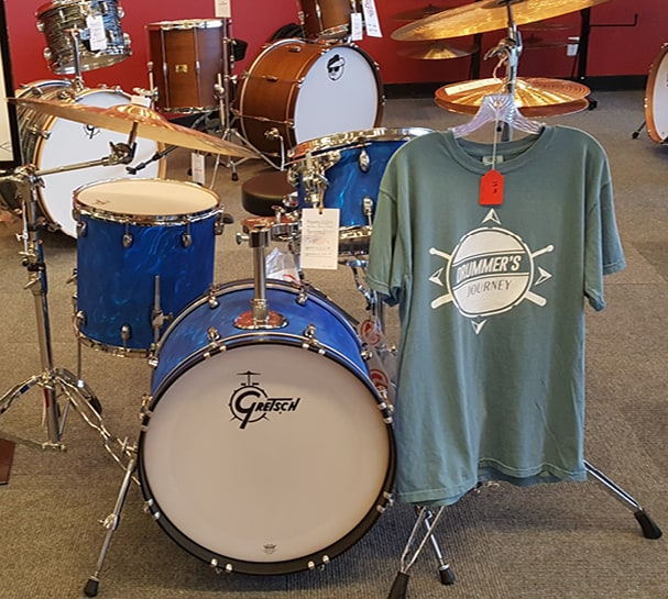 drumset with branded shirt hanging from symbol