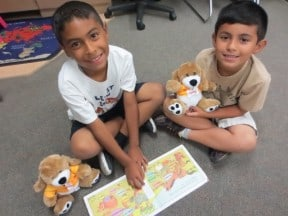 Dogs-help-kids-read-one-by-one-charitable-giving-program-4imprint