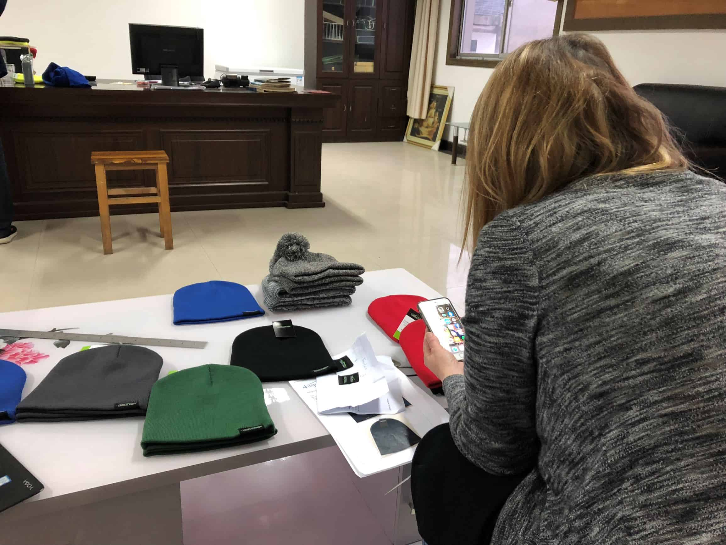 4imprint merchandiser reviewing the new Crossland promotional fleece beanie.