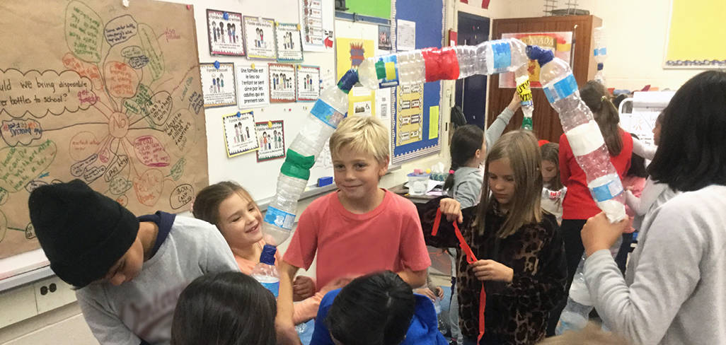 Children make projects out of water bottles.