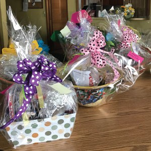May baskets containing custom brain-teaser books.