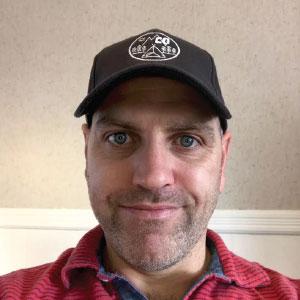Camp Quality Canada executive director wears a 4imprint custom cap.