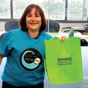 Female employee of Hydrocephalus Canada with promotional bag