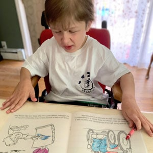Child using a promotional coloring book from Share the Voice.