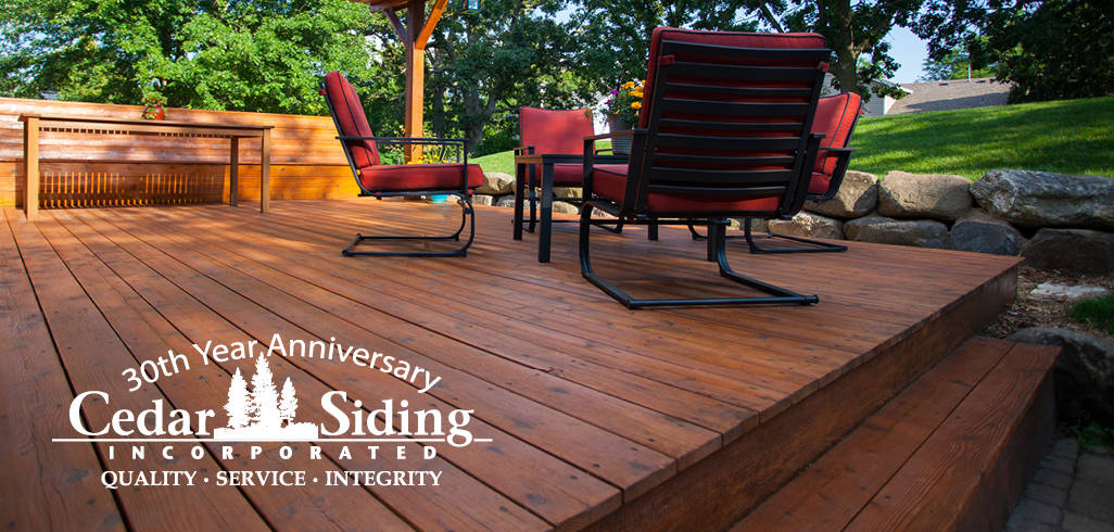 A picture of a deck with a 30th anniversary Cedar Siding Incorporated logo included.