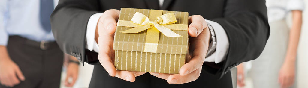 Person holding wrapped present