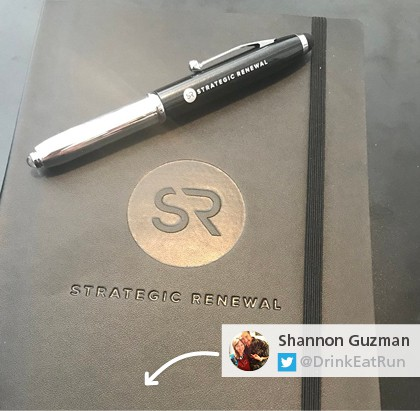 Photo of unique promotional pen sitting on top of matching branded journal
