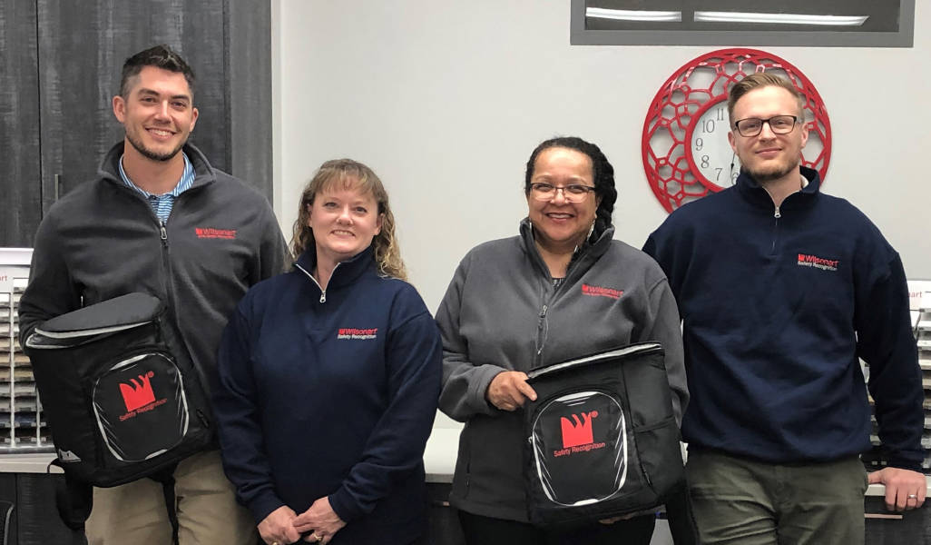 Staff members of Wilsonart showing branded clothing and bags.