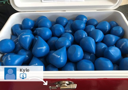 a cooler filled with water drop shapped stress balls as part of a stress ball giveaway for a trade show