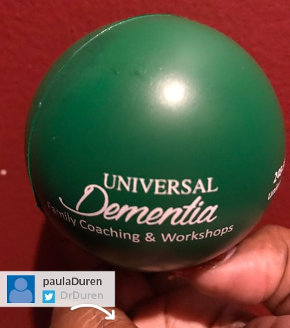 green promotional stress ball with Universal Dementia logo on it
