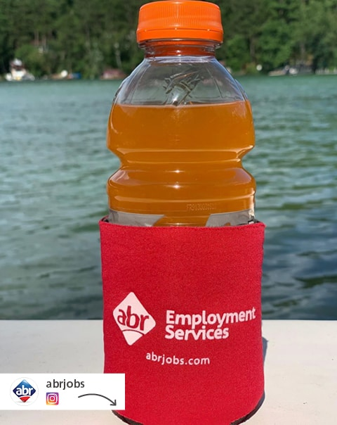 A social media post showing an abr Employment Services custom can cooler on a sports drink bottle.