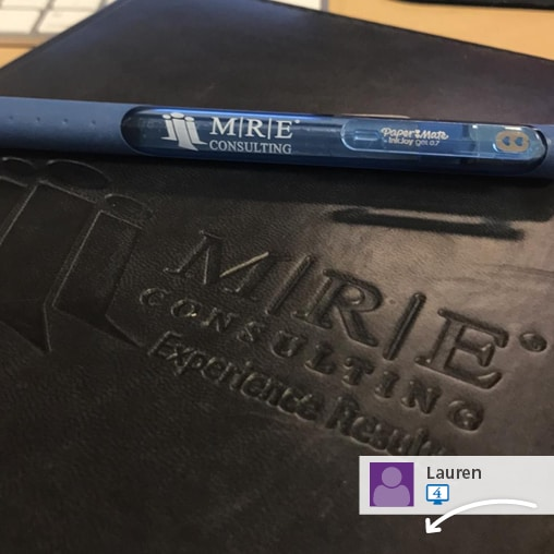 A social media post showing a promotional pen and joural.