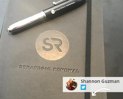Social media post showing a logoed pen and journal.