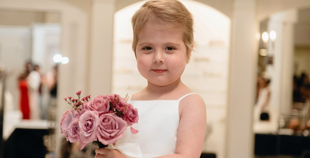 young girl trying on a bridal dress from Kleinfeld Bridal as part of a program through Runway Heroes - kids with cancer