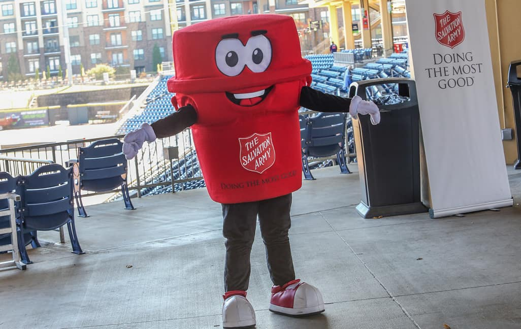 The salvation army red kettle mascot at a HOme Run Derby Kettle Kick Off event