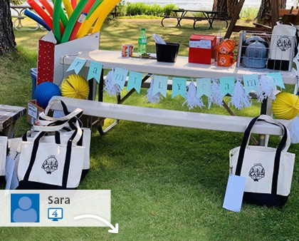 A social media picture of several promotional bags at an outdoor event