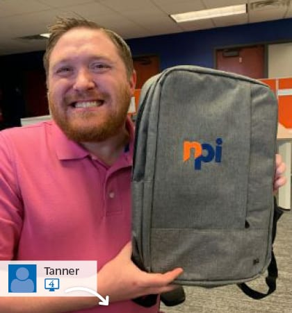Social media post with a man holding an NPI promotional backpack