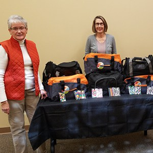 Jackson County GAL/CASA employees display the personalized sports duffel bags used for its CASA duffel bag project.