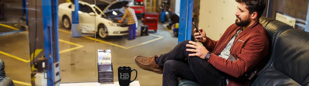 man waiting in auto repair shop