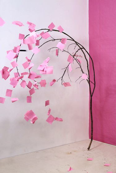 "A holiday ""wishing tree"" with pink notes"