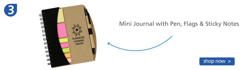 Number three: journal with sticky notes, flags and a pen